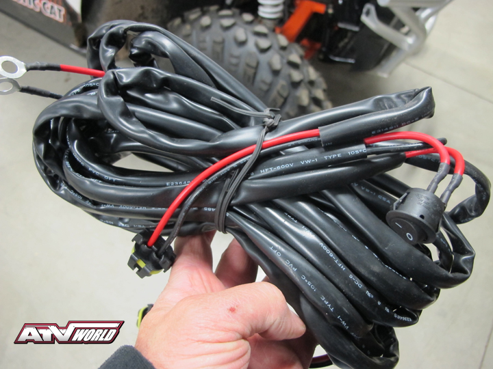 Biltrite also offers up two types of complete wiring harnesses (single light or double). Each harness is complete with battery hookup connectors and toggle switch. Long enough to mount lights virtually anywhere on the machine, you can simply zip-tie the excess wire up out of the way, meaning there are no wires to splice…simply plug and play.